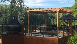 An image of the new pool near the hot tub and a view of the lake.